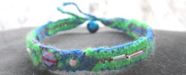 Unique friendship bracelets bespangled with colored beads and accessorized with bell